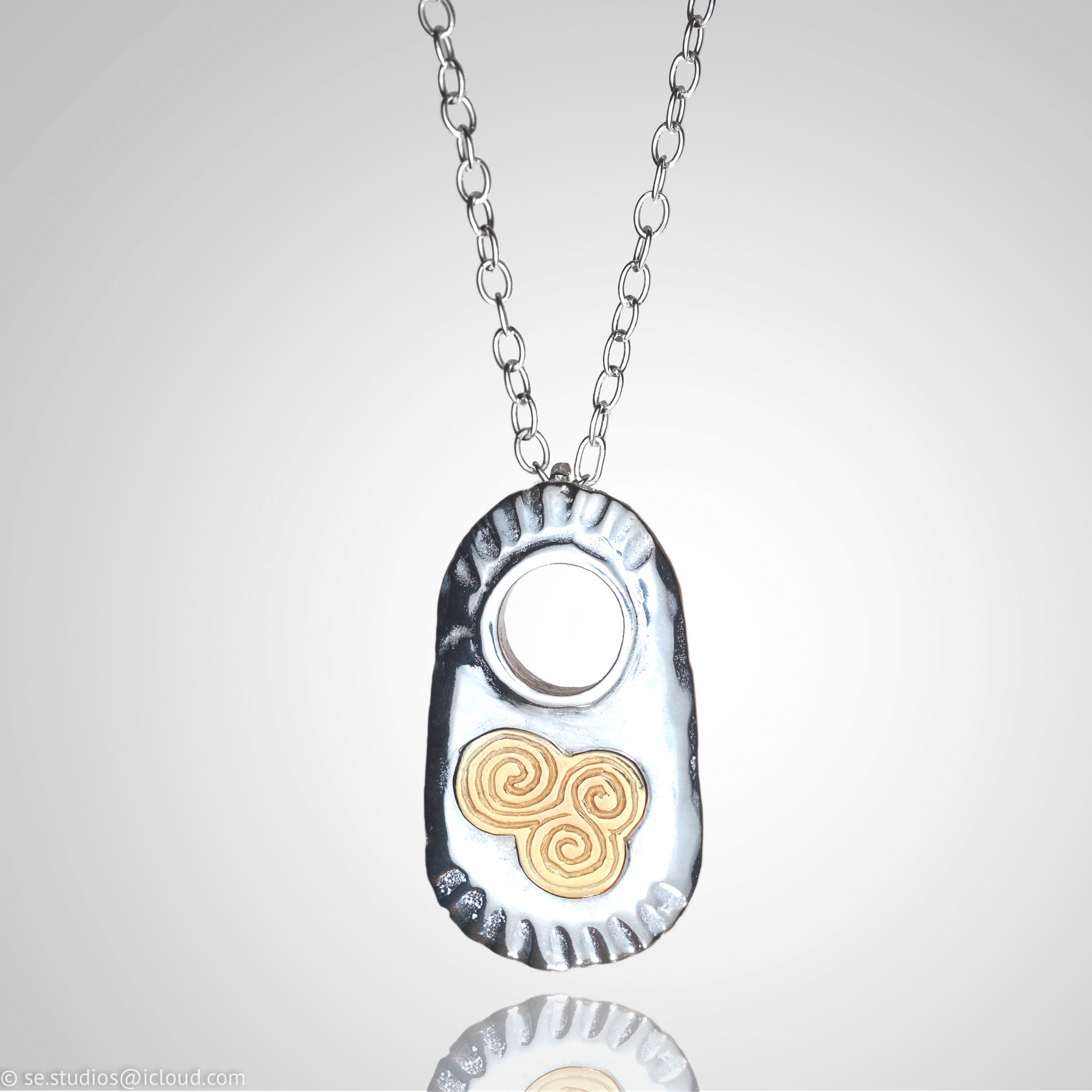 Silver Pendant With 9ct Gold Spiral